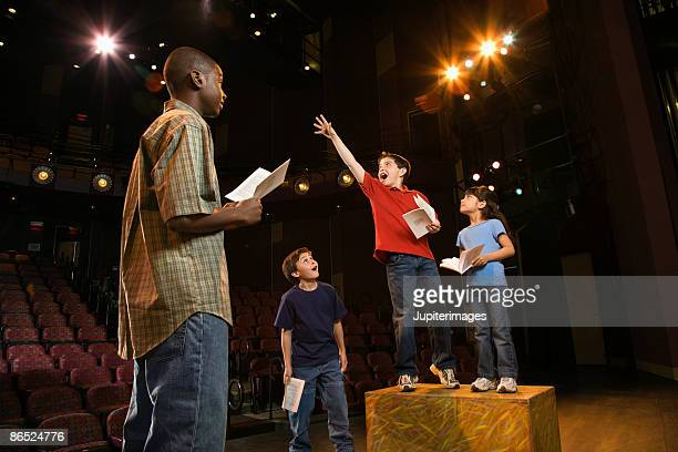 students practicing a play - rehearsal stock pictures, royalty-free photos & images