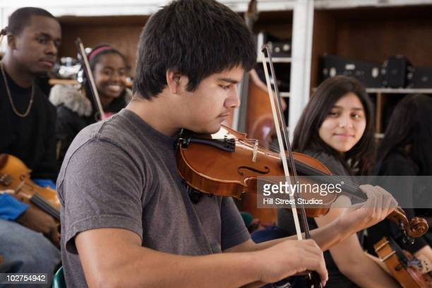 Students practicing in high school orchestra