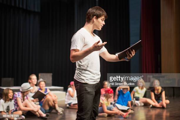 students practicing lines on stage - actor stockfoto's en -beelden