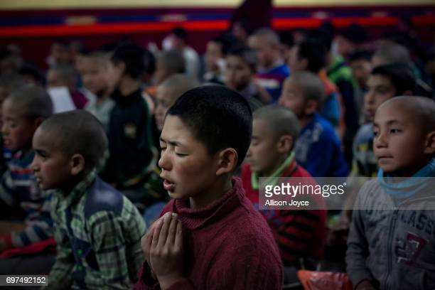 Students pray at the Jamyang school which is powered by solar energy on June 12 2017 in Leh Ladakh India The cold desert of Ladakh has been known as...
