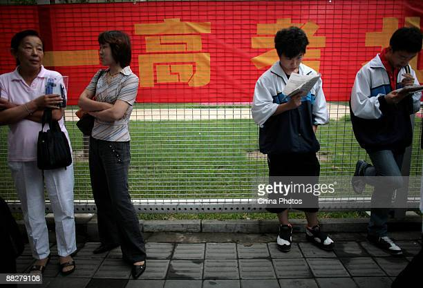 Students prepare to sit the National College Entrance Examination at an exam center on June 7 2009 in Beijing China About 102 million students will...