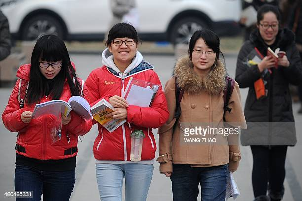 Students prepare to sit the National Entrance Examination for Postgraduate at a university in Beijing on January 4 2014 Millions of students will...