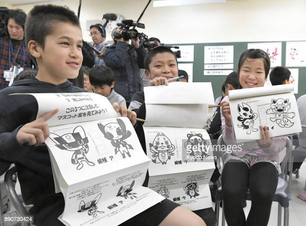 Students prepare to vote at an elementary school in Tokyo on Dec 11 to select which of the three pairs of candidate characters will become the...