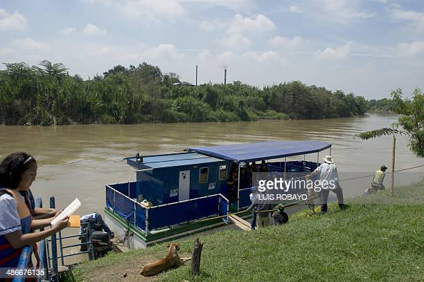 Students prepares to embark on the river boat school of the environmental institution CVC for a day of reading on the Cauca river of the novel...