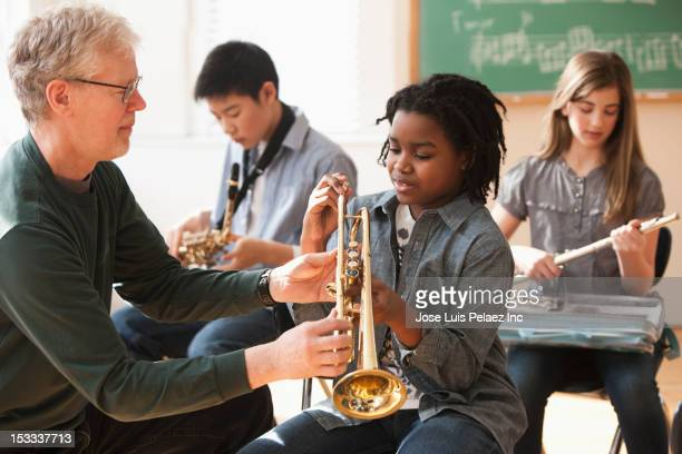 Students preparing to play musical instruments