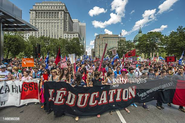 Students protest a hike in tuition fees on June 22 2012 in Montreal Canada After two weeks of relative calm tens of thousands of students were back...