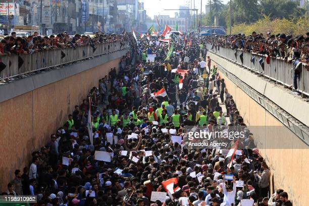Students protest against the assault carried out by supporters of Shia cleric Muqtada alSadr against Iraqi protesters in central Iraq province of...