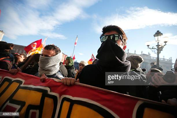 Students protest against the local government in downtown Turin on December 14, 2013. Protesters clashed with police during anti-austerity...