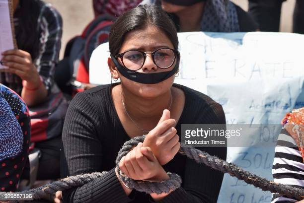 Students protest against the SSC exam scam in a unique way by putting a black band and tying their hands as they highlighted their demands on...