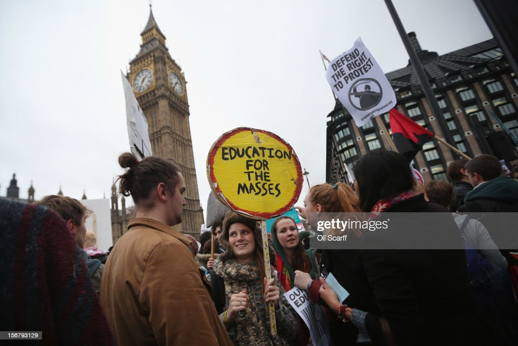 Students protest in front of the Houses of Parliament against the rising costs of further education on November 21, 2012 in London, England. The demonstration march was organised by the National Union of Students and is the first national student protest since a series of violent protests against tuition fees two years ago.