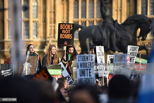 Students protest outside the Houses of Parliament during a march against university fees in London on November 19 2014 The demonstration organised by...