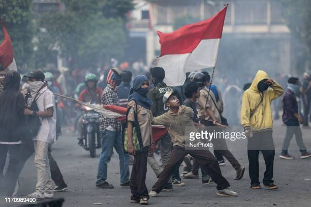Students protest outside the Indonesian Parliament in Jakarta Indonesia September 25 2019 Indonesian riot police shot multiple rounds of tear gas at...