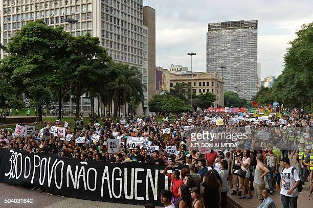 Students protest the country's latest round of transport fare hikes in Sao Paulo Brazil on January 8 2016 Amid a marked economic downturn and high...