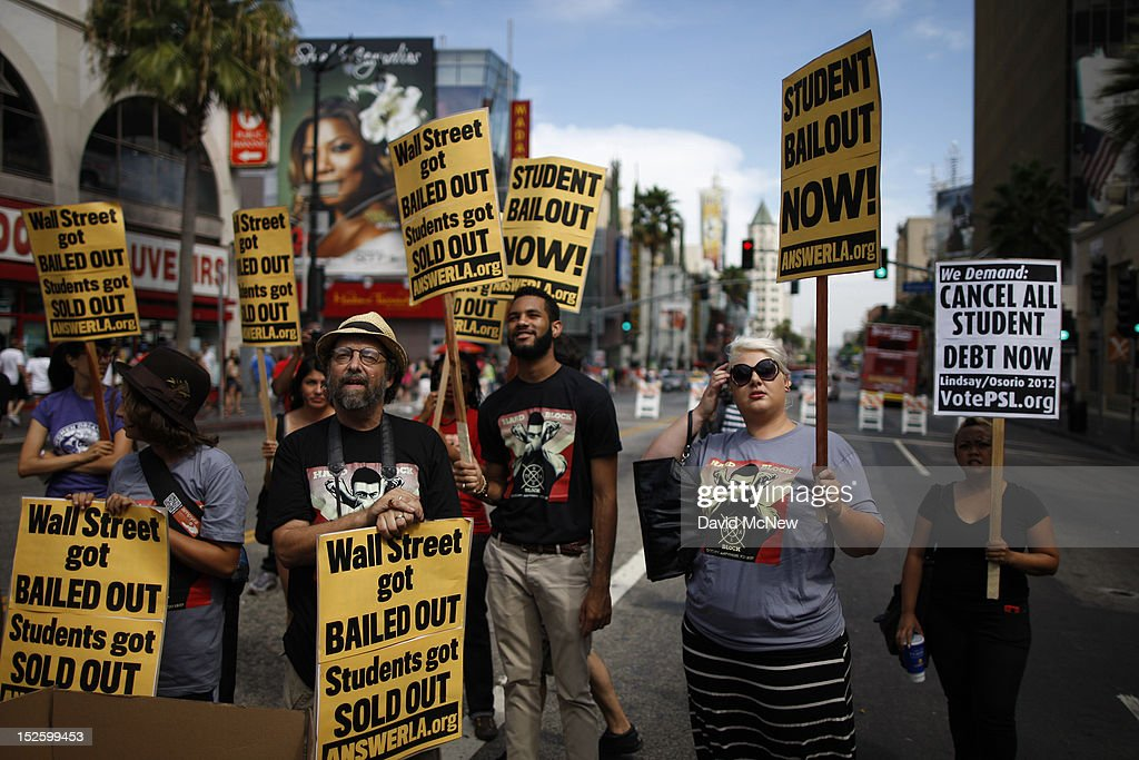 Students protest the rising costs of student loans for higher education on Hollywood Boulevard on September 22, 2012 in the Hollywood section of Los Angeles, California. Citing bank bailouts, the protesters called for student debt cancelations.