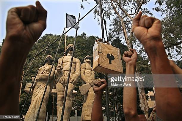 Students protesting by installing a symbol of jail around the OparajeoBangla demanding the release of the detained teachers and students who were...