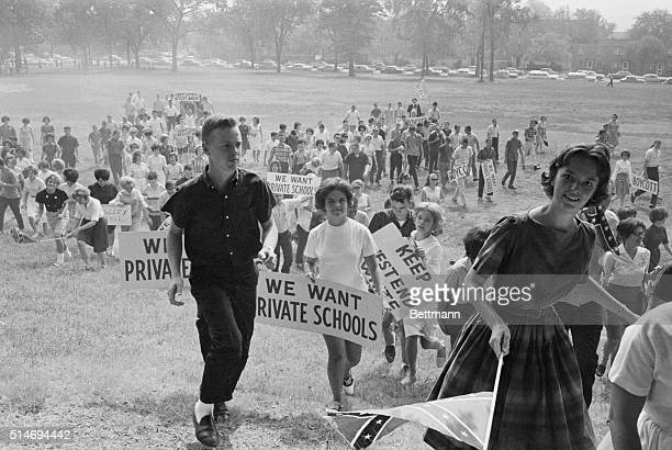 Students protesting integrated schools march toward a segregated school during a prosegregation protest in Birmingham Alabama