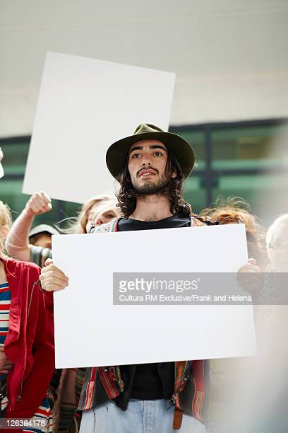 Students protesting with blank cards