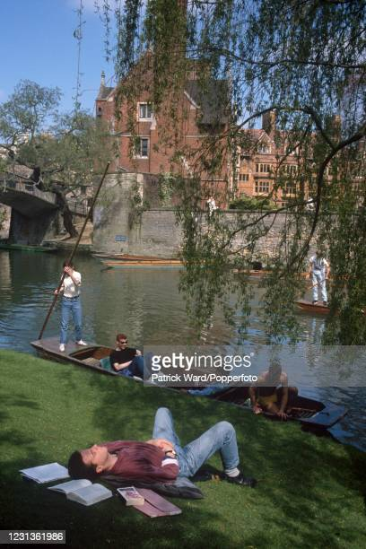 Students punting and relaxing on the River Cam at Cambridge University in England, circa May 1989. The University of Cambridge is a collegiate...