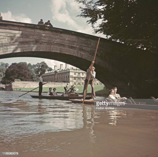 Students punting under the bridge over the River Cam by King's College in Cambridge circa 1950