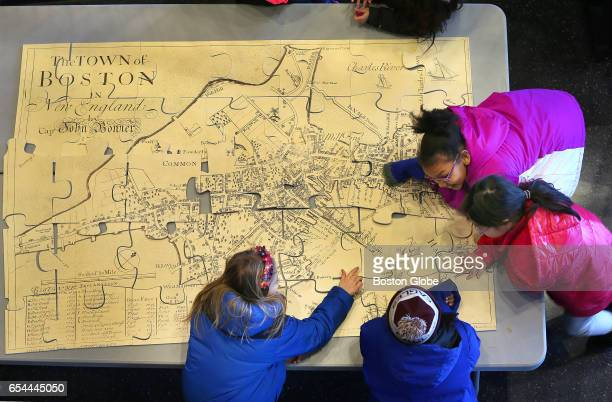 Students put together a puzzle of an old map of Boston at the Boston Public School Headquarters in Dudley Square in Boston on Mar 16 2017 This map...