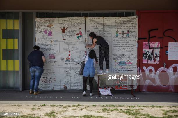 TOPSHOT Students put up satirical cartoons on the campus of the Nanterre University west of Paris on April 18 2018 during nationwide demonstrations...