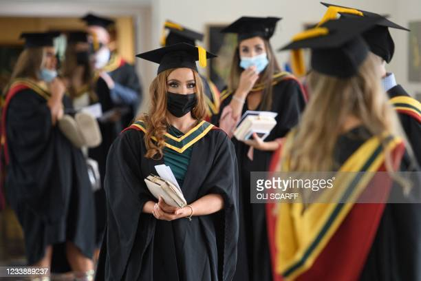 Students queue at the University of Bolton to receive their degree certificates in a Covid-safe, in-person graduation ceremony one of a handful...