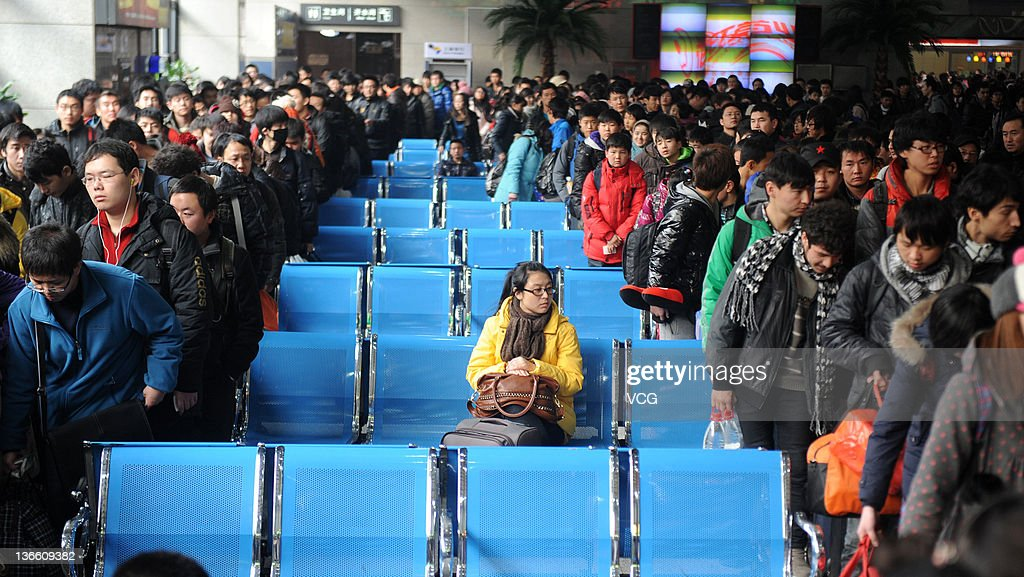 Students queue to take trains home at Beijing West Railway Station on January 8, 2012 in Beijing, China. China's annual Spring Festival travel rush begins today as authorities estimate 3.158 billion passenger journeys will be made for the Chinese lunar new year during the 40-day travel period.