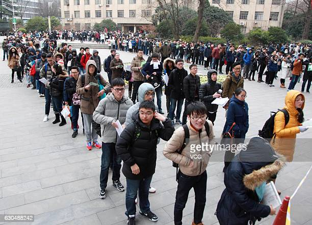 Students queue up before sitting 2017 National Entrance Examination for Postgraduate at Nanjing Forestry University on December 24 2016 in Nanjing...