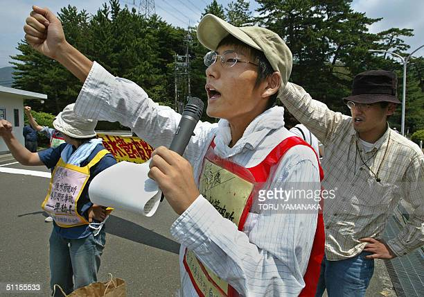 Students raise their fists as they shout antinuclearplant slogans in front of a nuclear power plant at Mihama 350 kilometres west of Tokyo 10 August...