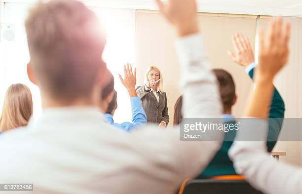 Students raising hands during class