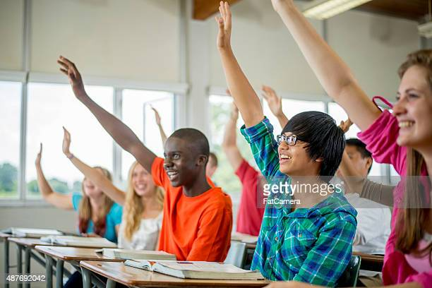 Students Raising Their Hands to Answer Questions