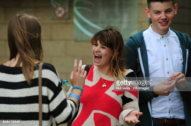 Students react after receiving their Alevel results at the Capital FM Arena Nottingham