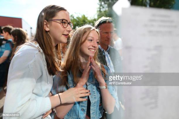 Students react as they check the results of the baccalaureat exam on July 5, 2017 in Cherbourg-Octeville, nothwestern France. / AFP PHOTO / CHARLY...