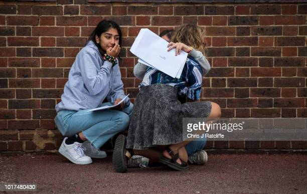 Students react as they open their A Level exam results at Lady Eleanor Holles school on August 16 2018 in Hampton United Kingdom A level examination...