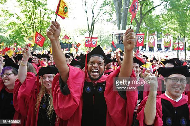 Students react as they prepare to receive their diplomas at commencement at Harvard University in Cambridge Mass on May 26 2016