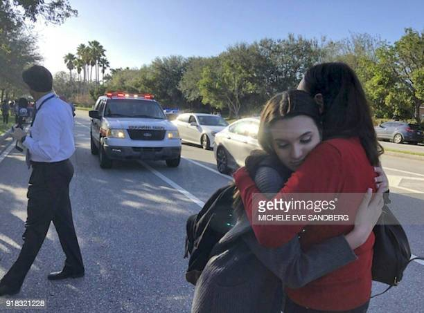 Students react at Marjory Stoneman Douglas High School in Parkland Florida a city about 50 miles north of Miami on February 14 2018 following a...