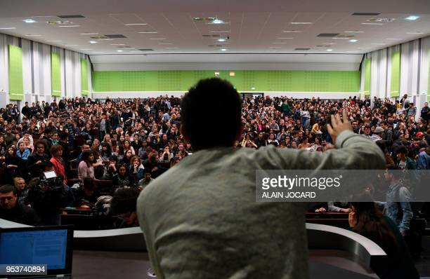 TOPSHOT Students react during a general assembly in Nanterre University west of Paris on May 2 2018 Students of Nanterre University voted on May 2...