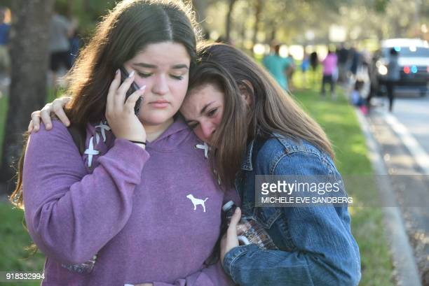 TOPSHOT Students react following a shooting at Marjory Stoneman Douglas High School in Parkland Florida a city about 50 miles north of Miami on...