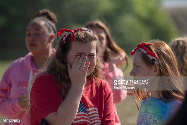 Students react outside Noblesville West Middle School after a shooting at the school on May 25 2018 in Noblesville Indiana One teacher and one...
