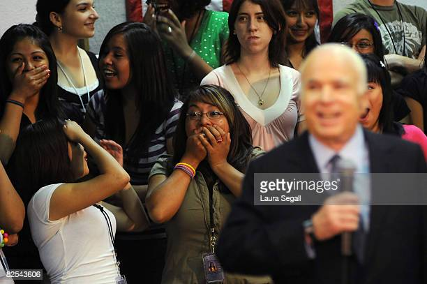 Students react to presumptive Republican presidential nominee Sen John McCain's announcement of his endorsement by Latin recording artist Daddy...