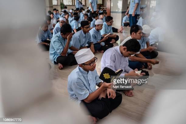 Students read the Quran at the alMukmin Islamic boarding school in Ngruki on January 23 2019 in Sukoharjo Central Java Indonesia The AlMukmin Islamic...