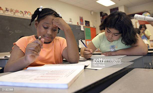 Students read their school work in Arlene Lebowitz's thirdgrade class during summer school July 2 2003 in Chicago Illinois A record number of...