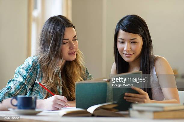students reading from book together. - nepalese ethnicity stock pictures, royalty-free photos & images