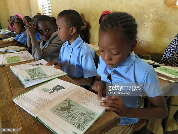 Students reading in school books at a Nigerian school on December 09 in Niamey Niger Photo by Ute Grabowsky/Photothek via Getty Images