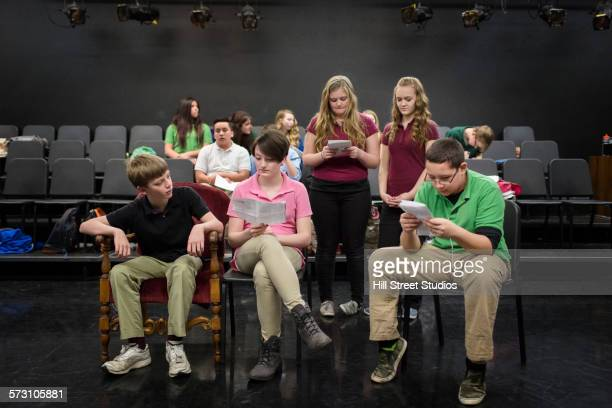 Students reading scripts in drama class