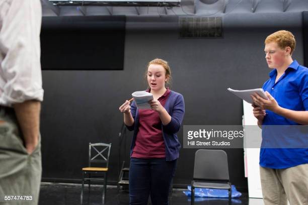 students reading scripts in high school drama class - actress stock pictures, royalty-free photos & images