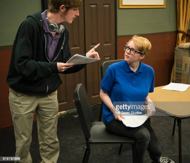 Students reading scripts in theater class