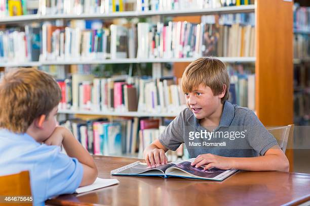 Students reading together in library
