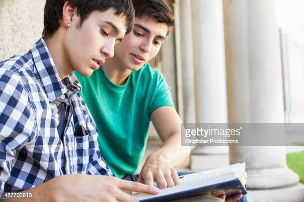 Students reading together on campus