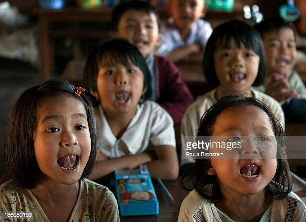 Students recite their lessons during class at a government run school December 16 2011 on Inle Lake Myanmar The education system is based on the...
